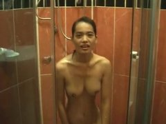 Breath taking Asian babe in the shower rubbing on her twat