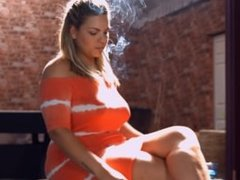 Molly M smoking strong corks cigarettes in the sunlight