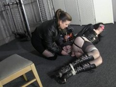Leggy domme hogtied with a pair of a Sissys panties stuffed in her mouth