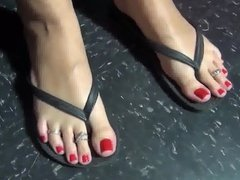 soles red toes on display