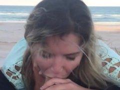 Girlfriend blows on the beach