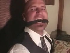 man in dress shirt tied and gagged