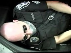 male cop kidnapped tied up gagged