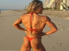 sexy muscle girl at the beach