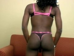 Naughty black tranny in lingerie is stroking her thick cock