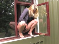 Desperate Blonde Peeing Out of Office Window