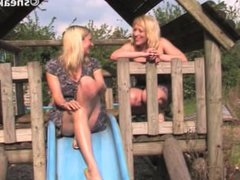 Another Hot blond Girl Pissing Down Park Slide