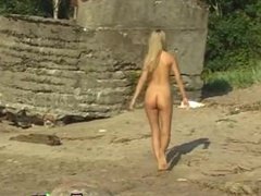 Blonde milf doggy Linda gets naked on the beach