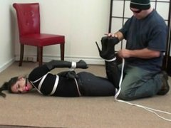 Sandra tied in boots