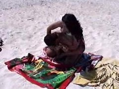 girl vs guy wrestle in beach