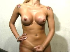 Latina t-girl exposes round tanned boobs with perky nipples