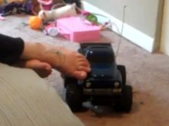 Giantess girl playing and crush toy car with her barefoot