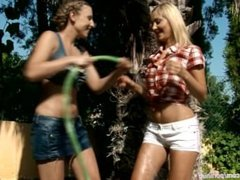 Seduced Gardener featuring Lena and Morgan splash each other with water and