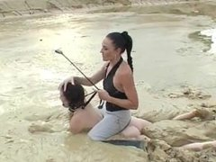 Mistress plays with muddy female slave