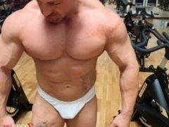 Bodybuilder Oiagan Flexing in Gym