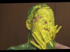 only one of girls covered paint