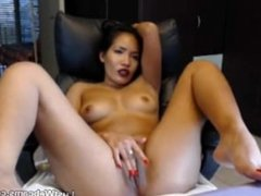 Asian chick toys her creamy pussy on webcam