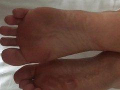 Footjob in hotel part II with big cumshot on soles