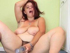 bbw hairy milf  stuffs a glass dildo her butthole