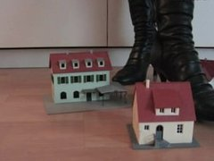 Model railway houses under sexy boots