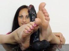 Sexy brunette oiled feet
