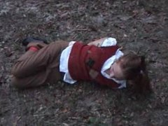Coed hogtied and ballgagged in woods