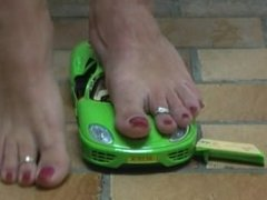 Giantess crushes green toy car barefoot