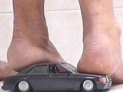 Girls crushing Mercedes toy car
