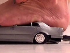 Giantess crushes silver mercedes toy car