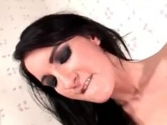 Dark-haired beauty is peeing in the mouth