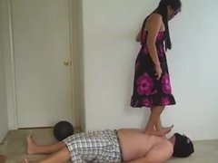 Trampling stomping her husband very hard