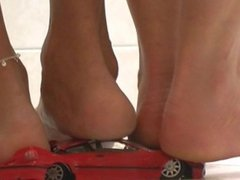 Two Women Decimate A Car Under Bare Feet and Heels