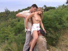 Katy Caro Looks Hot Kneeling between Two Guys Giving Them a Blowjob