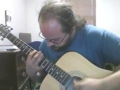 me, devin ray spurling, playing my guitar. me playing and stuff and a tribu