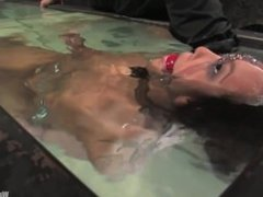 Hot Asian babe is here for her first water bondage