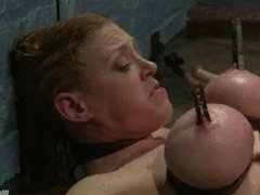 Busty babe proves she's a worthy sex slave through water bondage