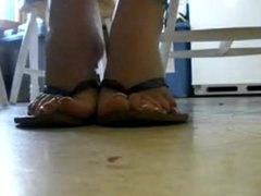 Sweaty Feet Doing Toe Curls and Scratching in Sandals