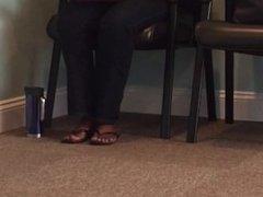 Waiting room feet in flip flops