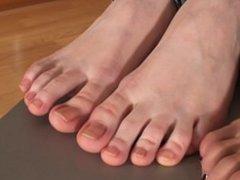 Girls feet curling toes