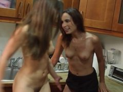 Two horny lesbians get it on in the office kitchen