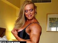 Female bodybuilder flexing strong arms