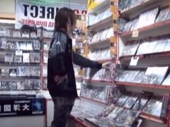 Japanese Woman Licking a Man's Face Good in Video Store