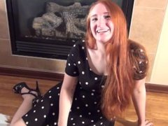 redhead masturabtion by the fireplace
