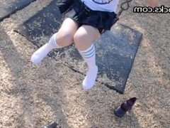 School girl at the park in short skirt and knee socks