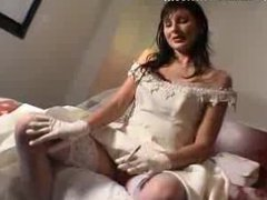 Bride on Bed Smoking In Wedding Dress