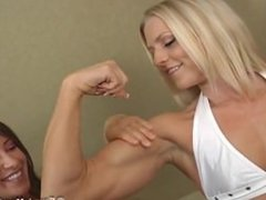 Girl worships another girl's biceps.