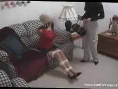 Two girls tied up by a third