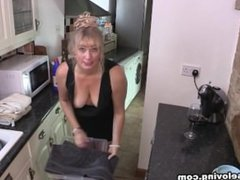 Melissa blonde mature lady downblouse while cleaning in tight black dress 1