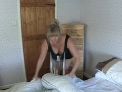 Melissa blonde mature lady downblouse while cleaning in tight black dress 3
