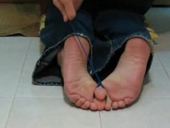 Beuty girl barefoot on hot wax